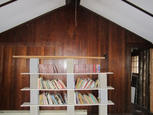As purchased - bookshelves (of a sort) cover the old door opening.